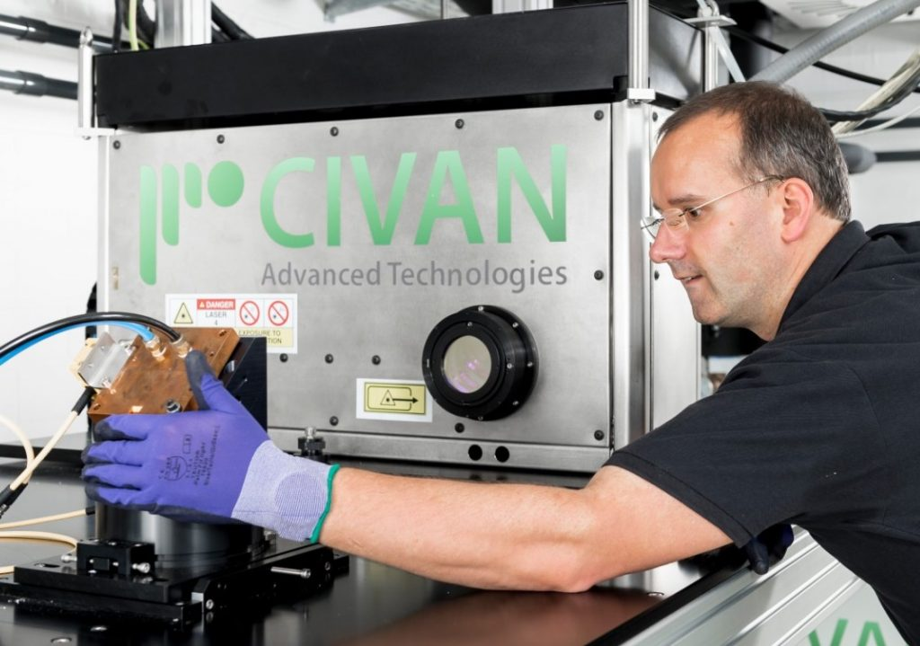 An engineer installing the 'Dynamic Beam Laser' from Jerusalem at Fraunhofer IWS in Dresden.