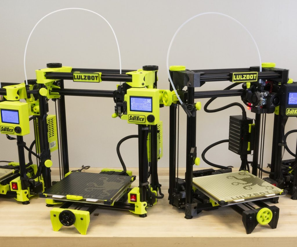 A straight on shot of two LulzBot SideKick 3D printers.