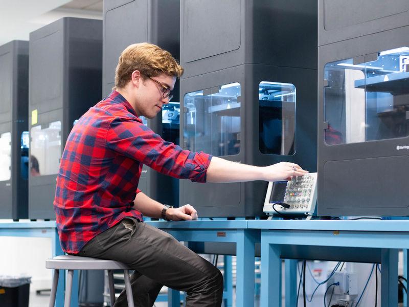 An engineer operating Markforged Metal X 3D printers.