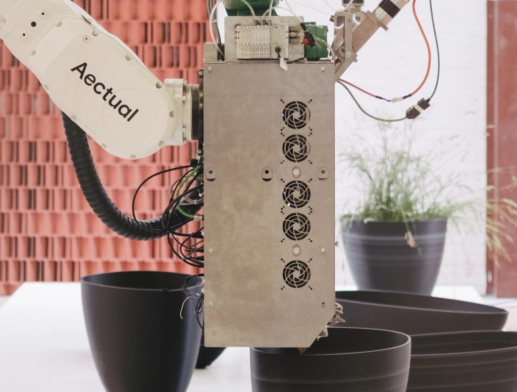 One of Aectual's 3D printers producing an eco-friendly planter.