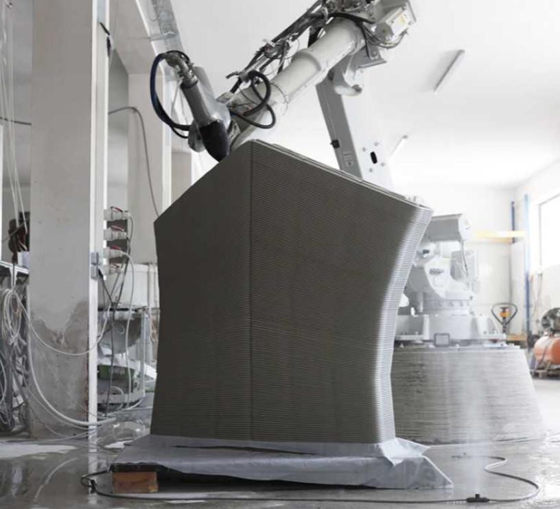 3D printing a concrete block for the Striatus bridge. Photo via Studio Naaro.