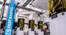 Four Carbon 3D printers installed inside one of Fast Radius' microfactories.