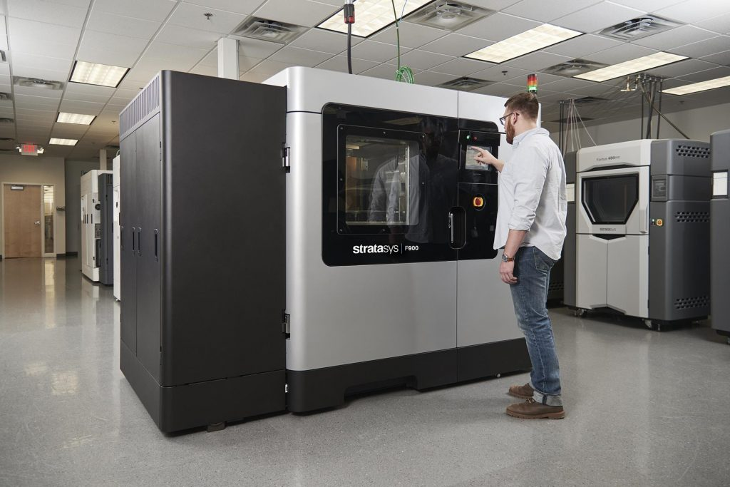 An engineer using Stratasys' F900 3D printer.