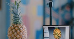 The premium edition of Creality's CR-Scan 01 being used to scan a pineapple.