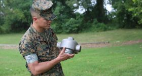 CWO2 Justin Trejo displays a 3D printed headcap for a rocket motor used to employ a M58 Mine Clearing Line Charge. Photo via Tonya Smith/US Marine Corps.