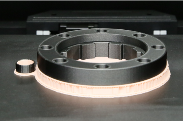 A part produced using Raise3D's Industrial PA12 CF material with breakaway supports.