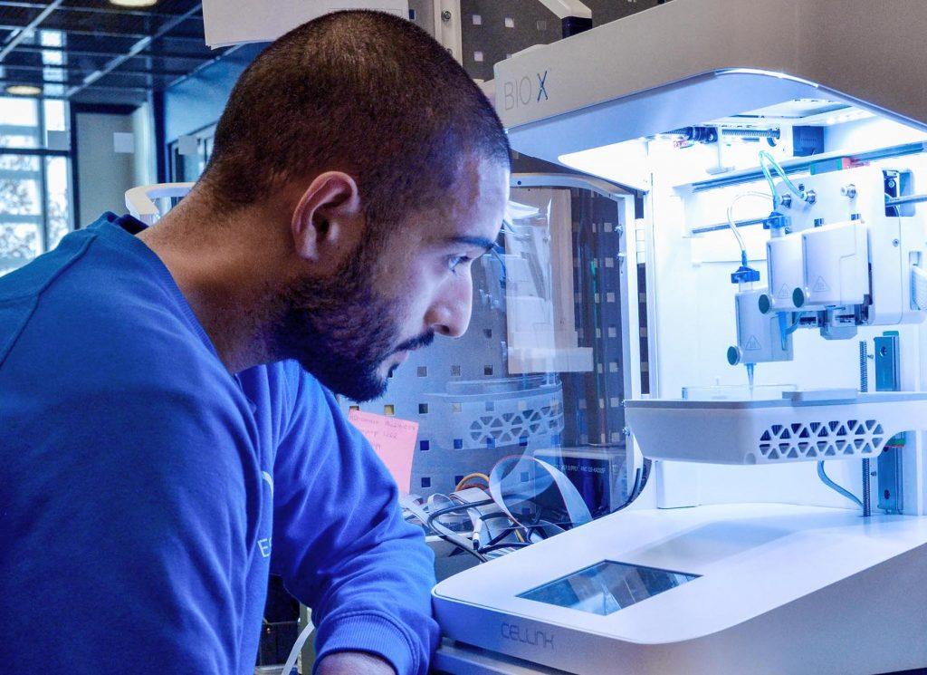 A scientist using a CELLINK 3D bioprinter.