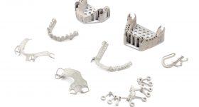 Dental applications 3D printed in chrome cobalt on Shop System. Photo via Desktop Health.