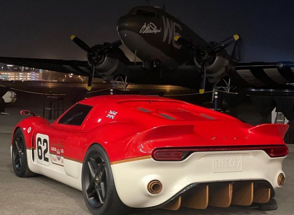 Radford's limited edition 62-2 race car in 'Gold Leaf' trim in front of an Army plane.