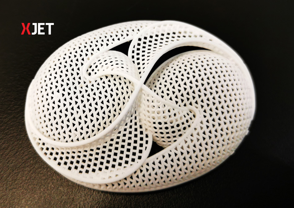 Alumina is now available for additive manufacturing on XJet AM systems. Photo via XJet.