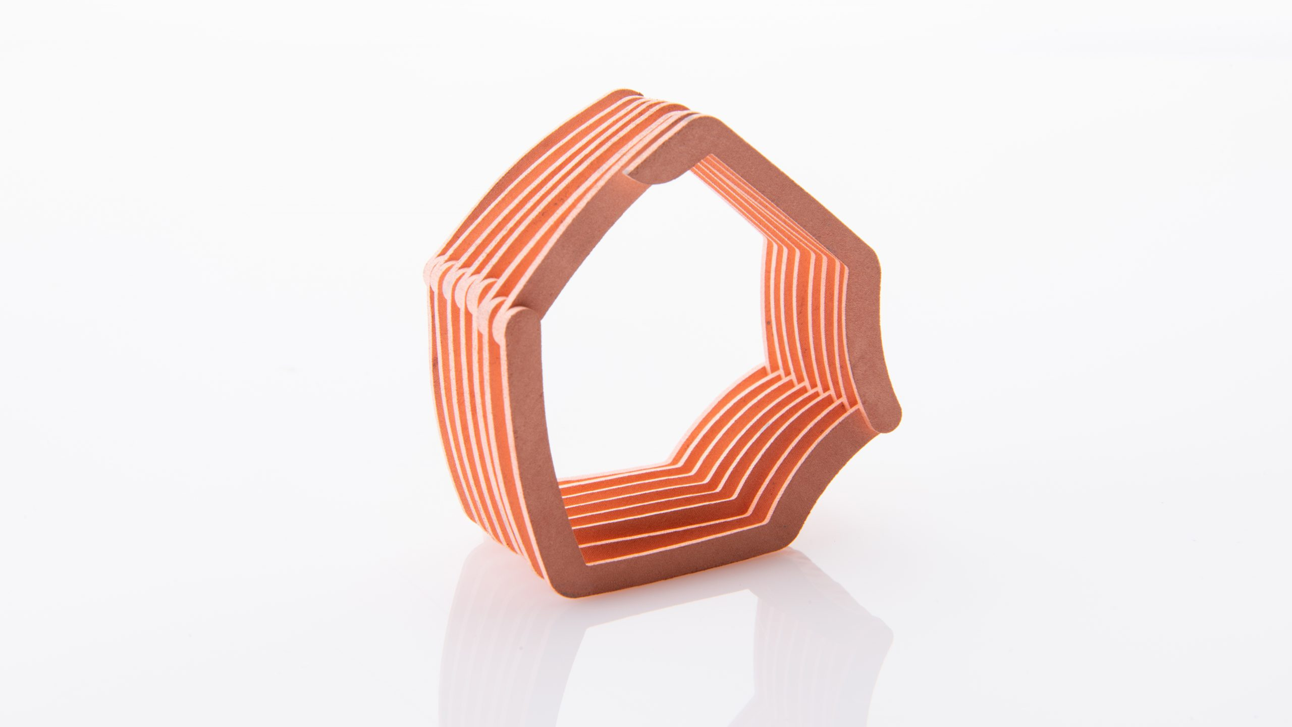 ExOne and Maxxwell Motors have successfully proved out a new concept for binder jet 3D printing a high-efficiency copper e-winding design. Photo via ExOne/Business Wire.