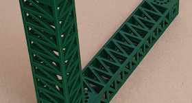 Two 3D printed PLA beams secured together. Photo via RepRap.