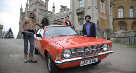 Car SOS TV hosts (left and center) and Bobby Singh, owner of the restored Ford Cortina Mark III after the grand reveal (right). Photo via Car SOS.
