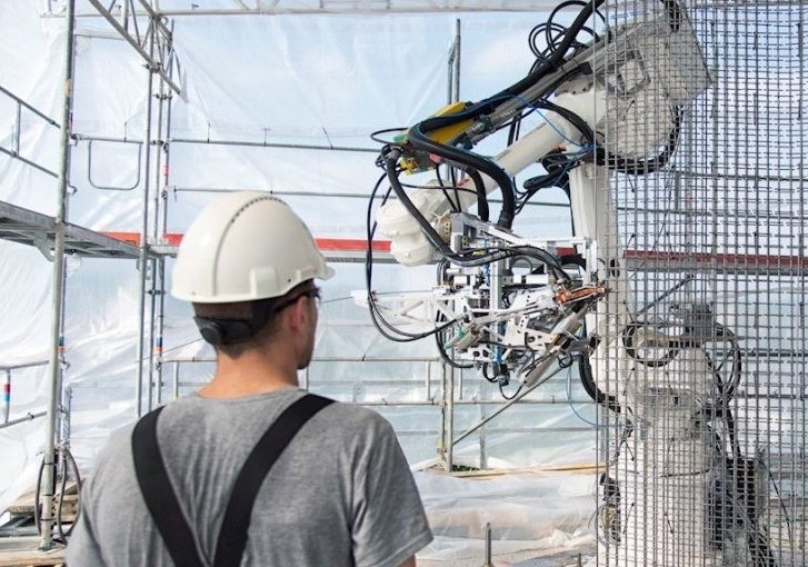 An engineer using a robotic-mounted construction system.