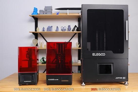 Elegoo's Jupiter alongside its Mars and Saturn 3D printers.