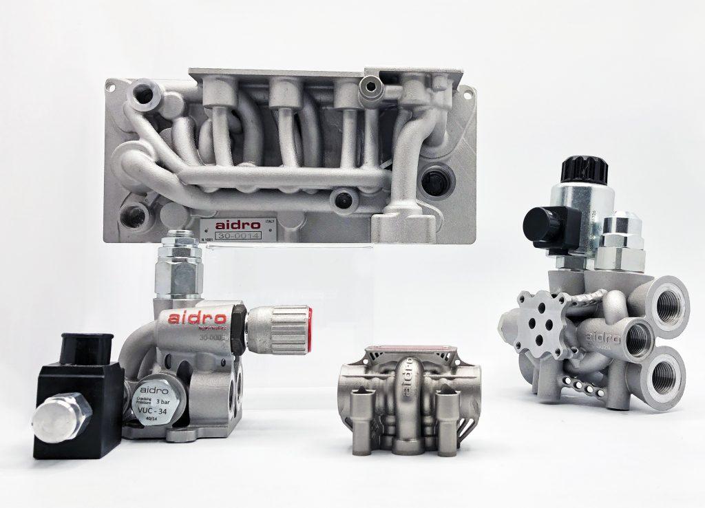 A selection of Aidro 3D printed hydraulic parts. Image via Aidro.