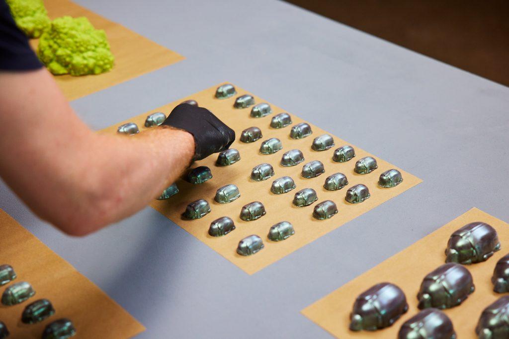 These chocolate beetles were cast using a food-safe Multiplier mold. Photo via Mayku.