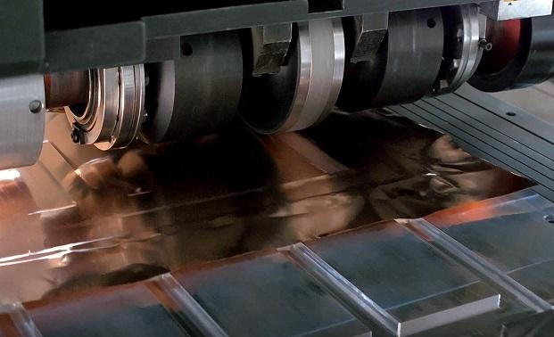 SonicLayer X̅ seam welding in action to produce copper foil onto copper busbar, small. Photo via Fabrisonic.