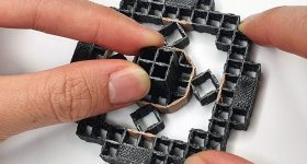 The metamaterial is made up of rows of repeated cells, with conductive walls acting as the electrodes. Photo via MIT.