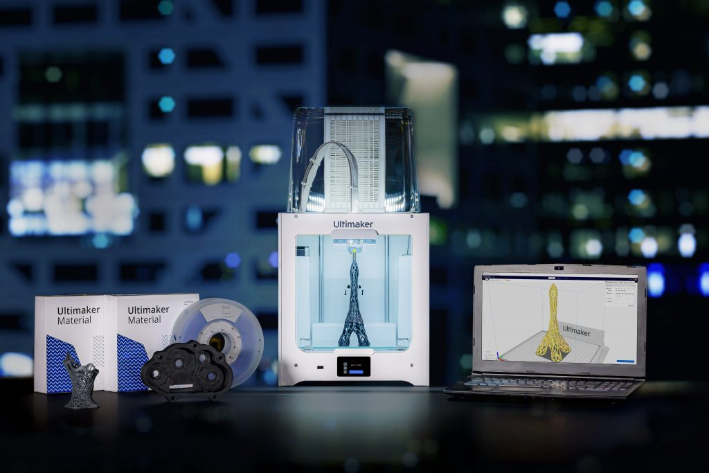 An Ultimaker 3D printer along with related materials and software.