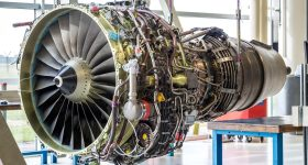 A jet engine undergoing overhaul at an MRO facility.