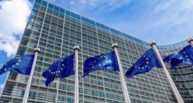 EU flags flying outside the European Commission.