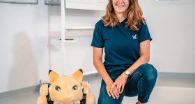 ETH Zurich's Andrina Grimm alongside her 'Dyana' robotic cat.