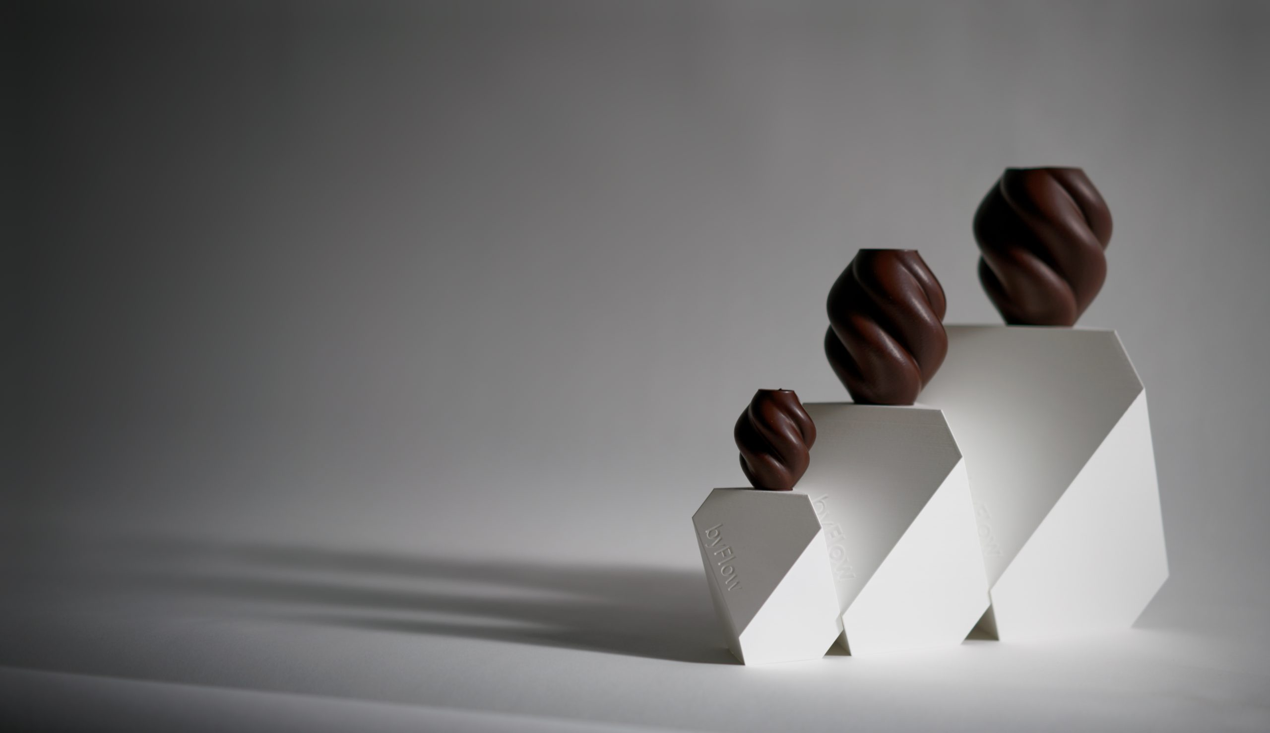 3D printed chocolate spiral vases. Photo via byFlow.