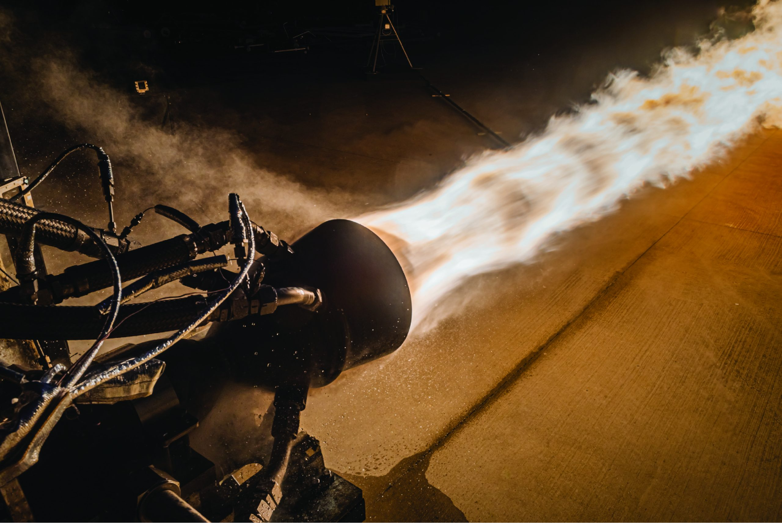 Launcher conducts a hot fire test for its 3D-printed Engine-2 rocket engine in the E Test Complex at NASA's Stennis Space Center. Photo via Launcher/John Kraus Photography.